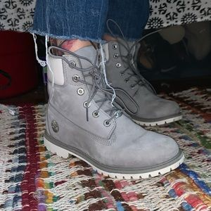 Gray and white Timberlands